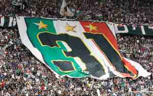 "Juventus' supporters display a large Italian flag representing the 31st ""Scudetto"" victory at the end of the team's Italian Serie A soccer match against Palermo in Turin"